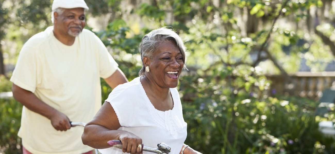 Senior couple riding bikes together in a park