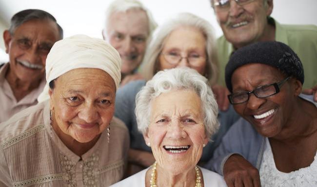 Diverse group of seniors smiling at the camera