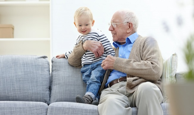 Homepage small ad with senior man and toddler sitting on a couch